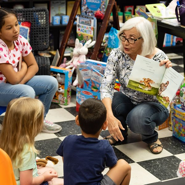 Author Marta Magellan reading The Nutty Little Vulture to children